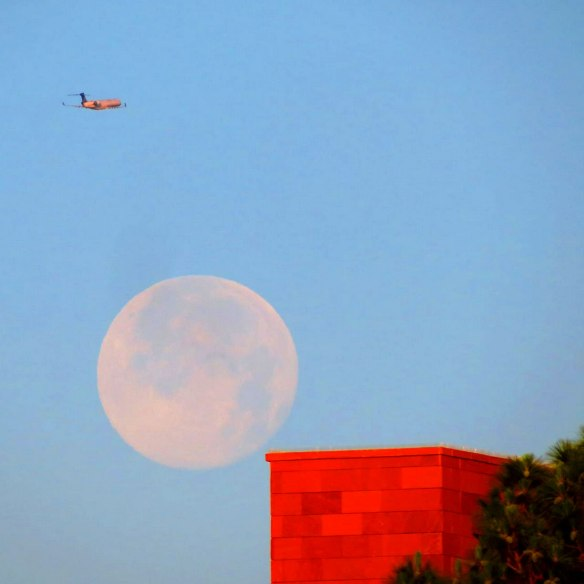 jmiller_red_building_moon_plane_570
