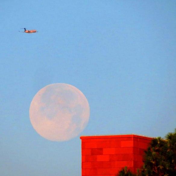 jmiller_red_building_moon_plane_570